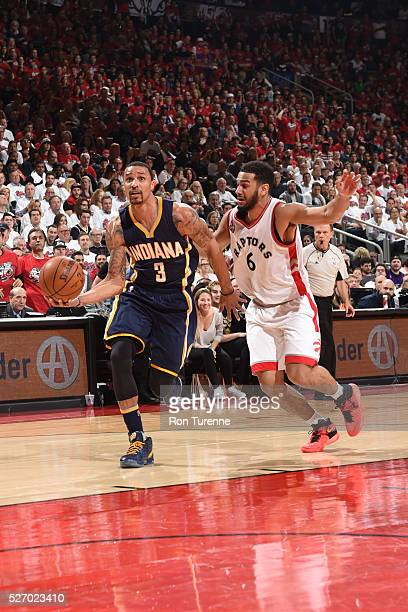 George Hill of the Indiana Pacers drives to the basket against Cory Joseph of the Toronto Raptors in Game Seven of the Eastern Conference...