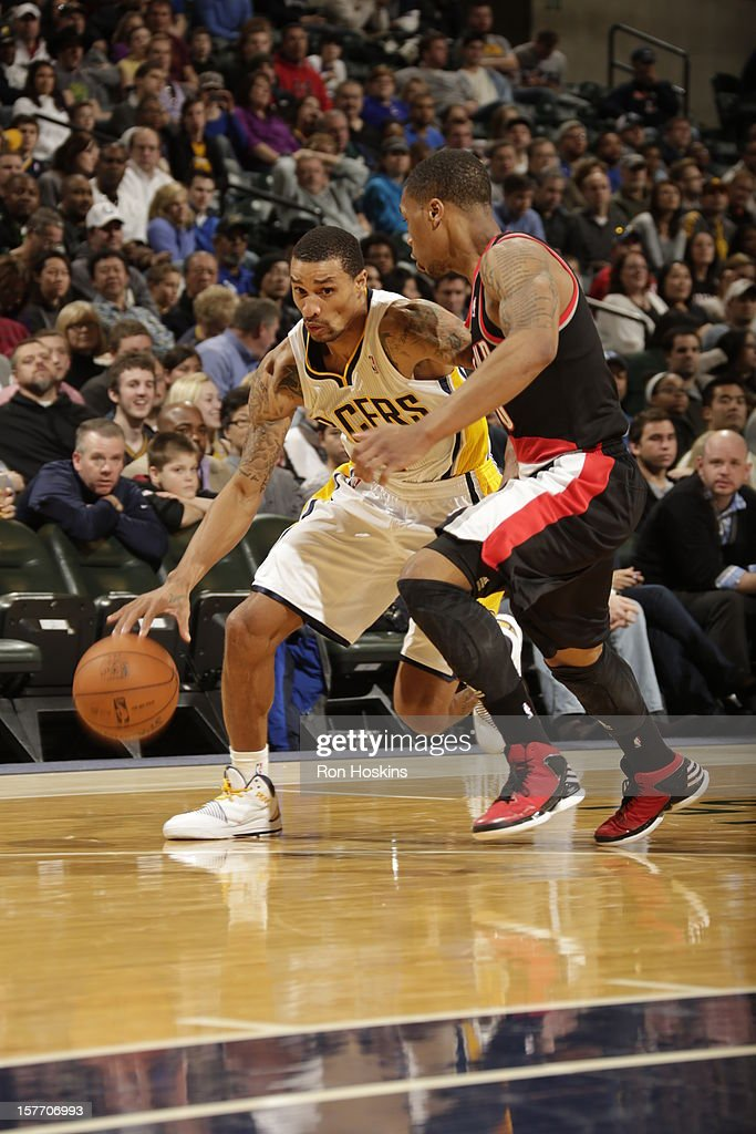 George Hill #3 of the Indiana Pacers drives to the basket against <a gi-track='captionPersonalityLinkClicked' href=/galleries/search?phrase=Damian+Lillard&family=editorial&specificpeople=6598327 ng-click='$event.stopPropagation()'>Damian Lillard</a> #0 of the Portland Trail Blazers on December 5, 2012 at Bankers Life Fieldhouse in Indianapolis, Indiana.