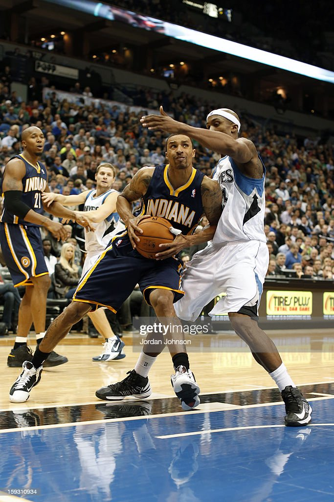George Hill #3 of the Indiana Pacers drives to the basket against <a gi-track='captionPersonalityLinkClicked' href=/galleries/search?phrase=Dante+Cunningham&family=editorial&specificpeople=683729 ng-click='$event.stopPropagation()'>Dante Cunningham</a> #33 of the Minnesota Timberwolves on November 9, 2012 at Target Center in Minneapolis, Minnesota.