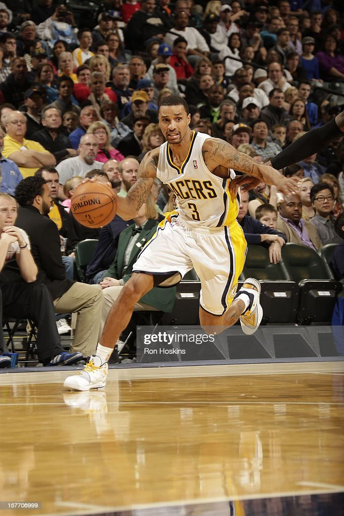 George Hill #3 of the Indiana Pacers drives to the basket against the Portland Trail Blazers on December 5, 2012 at Bankers Life Fieldhouse in Indianapolis, Indiana.