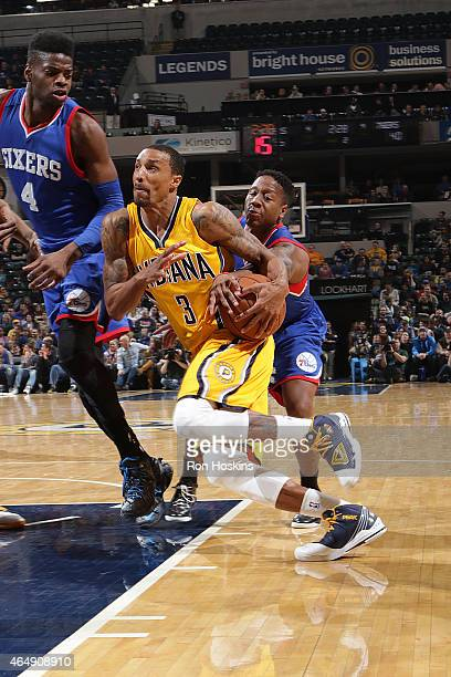 George Hill of the Indiana Pacers drives to the basket against the Philadelphia 76ers during the game on March 1 2015 at Bankers Life Fieldhouse in...