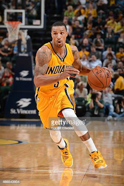George Hill of the Indiana Pacers drives to the basket against the Toronto Raptors during the game on March 16 2015 at Bankers Life Fieldhouse in...