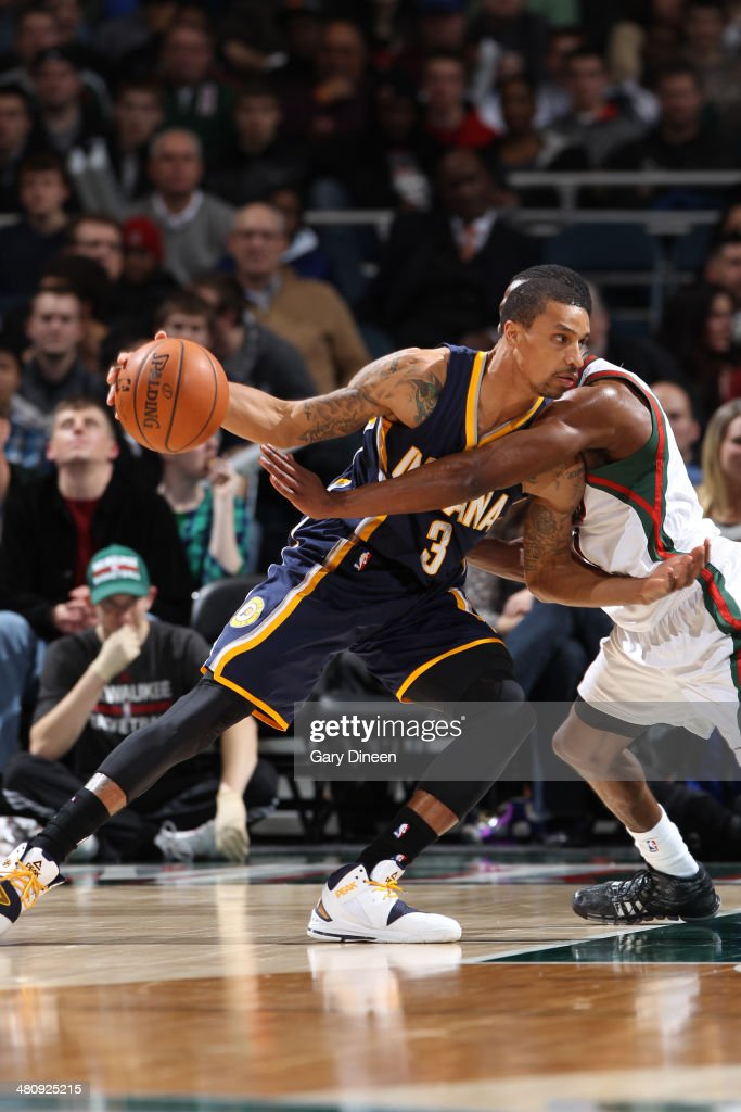 George Hill #3 of the Indiana Pacers drives to the basket against the Milwaukee Bucks on February 22, 2014 at the BMO Harris Bradley Center in Milwaukee, Wisconsin.