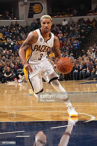 George Hill of the Indiana Pacers drives to the basket against the Minnesota Timberwolves at Bankers Life Fieldhouse on November 13 2015 in...