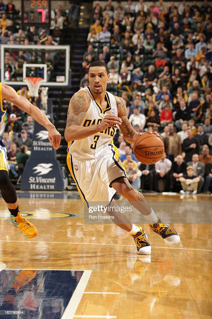 George Hill #3 of the Indiana Pacers drives to the hoop against the Golden State Warriors on February 26, 2013 at Bankers Life Fieldhouse in Indianapolis, Indiana.