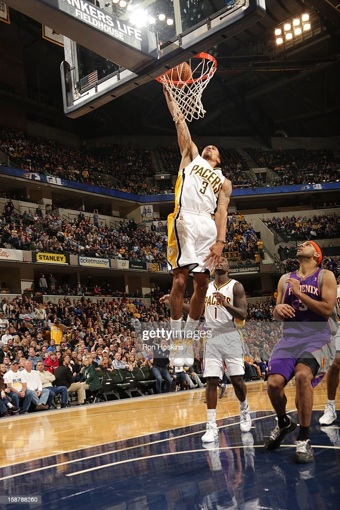 George Hill #3 of the Indiana Pacers dunks against the Phoenix Suns on December 28, 2012 at Bankers Life Fieldhouse in Indianapolis, Indiana.