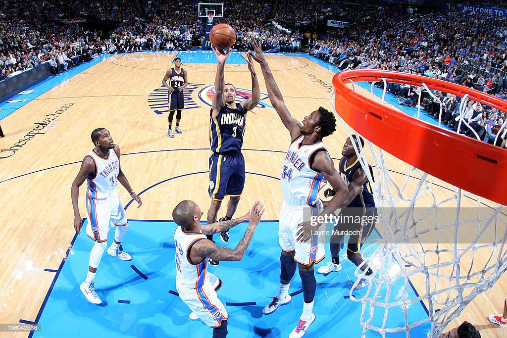 George Hill #3 of the Indiana Pacers goes to the basket against <a gi-track='captionPersonalityLinkClicked' href=/galleries/search?phrase=Hasheem+Thabeet&family=editorial&specificpeople=4003778 ng-click='$event.stopPropagation()'>Hasheem Thabeet</a> #34 of the Oklahoma City Thunder during the game between the Oklahoma City Thunder and the Indiana Pacers on December 9, 2012 at the Chesapeake Energy Arena in Oklahoma City, Oklahoma.