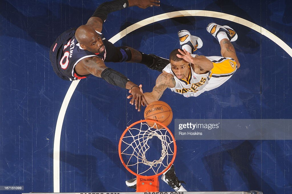 George Hill #3 of the Indiana Pacers goes to the basket against <a gi-track='captionPersonalityLinkClicked' href=/galleries/search?phrase=Johan+Petro&family=editorial&specificpeople=564344 ng-click='$event.stopPropagation()'>Johan Petro</a> #10 of the Atlanta Hawks during the Game One of the Eastern Conference Quarterfinals between the Indiana Pacers and the Atlanta Hawks on April 21, 2013 at Bankers Life Fieldhouse in Indianapolis, Indiana.