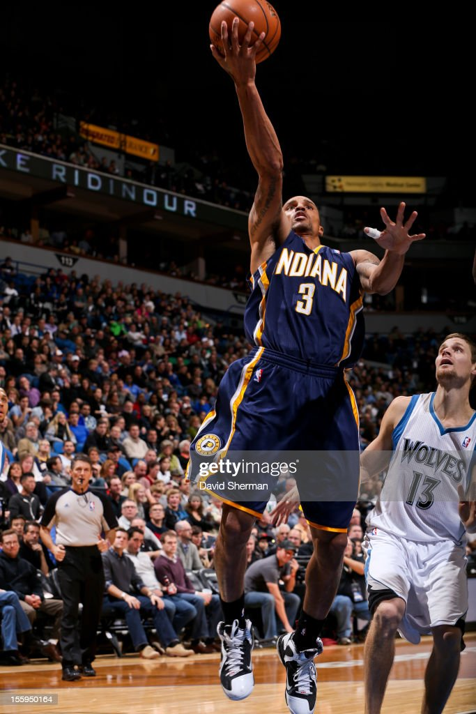 George Hill #3 of the Indiana Pacers goes to the basket against Luke Ridnour #13 of the Minnesota Timberwolves on November 9, 2012 at Target Center in Minneapolis, Minnesota.