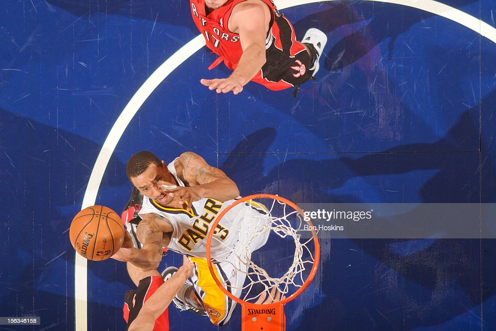 George Hill #3 of the Indiana Pacers goes to the basket against the Toronto Raptors on November 13, 2012 at Bankers Life Fieldhouse in Indianapolis, Indiana.