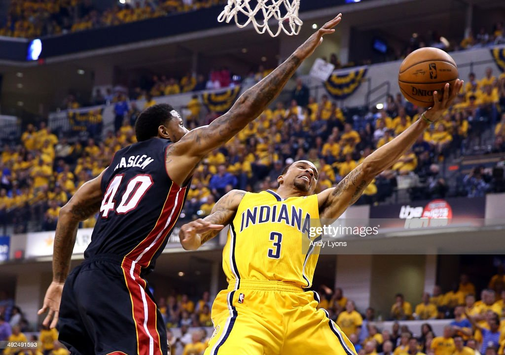 George Hill #3 of the Indiana Pacers goes to the basket as Udonis Haslem #40 of the Miami Heat defends during Game Two of the Eastern Conference Finals of the 2014 NBA Playoffs at at Bankers Life Fieldhouse on May 20, 2014 in Indianapolis, Indiana.