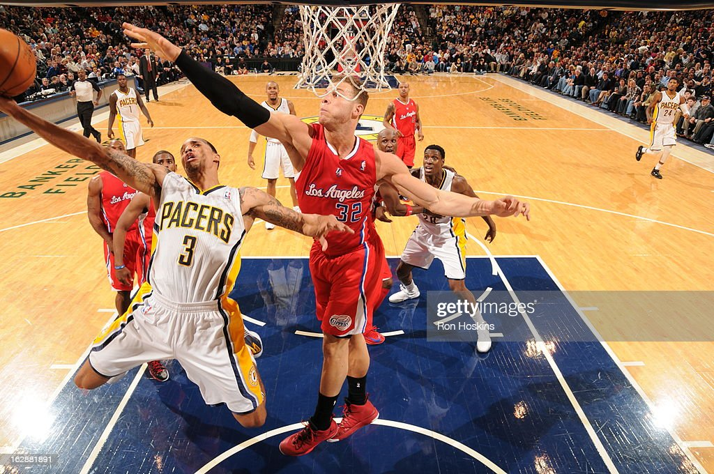 George Hill #3 of the Indiana Pacers goes up for the awkward shot against the Los Angeles Clippers on February 28, 2013 at Bankers Life Fieldhouse in Indianapolis, Indiana.