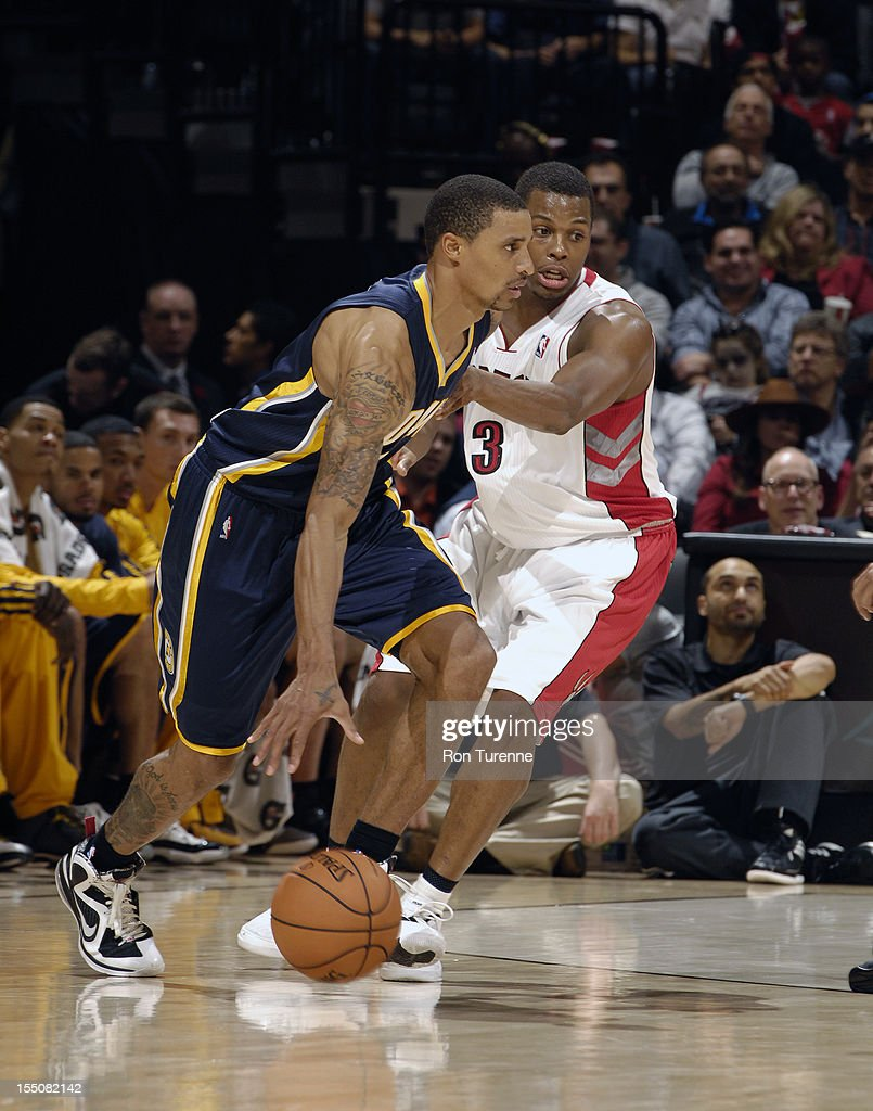 George Hill #3 of the Indiana Pacers handles the ball against <a gi-track='captionPersonalityLinkClicked' href=/galleries/search?phrase=Kyle+Lowry&family=editorial&specificpeople=714625 ng-click='$event.stopPropagation()'>Kyle Lowry</a> #3 of the Toronto Raptors on October 31, 2012 at the Air Canada Centre in Toronto, Ontario, Canada.