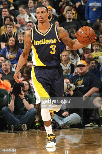 George Hill of the Indiana Pacers handles the ball against the Golden State Warriors on February 22 2015 at Bankers Life Fieldhouse in Indianapolis...
