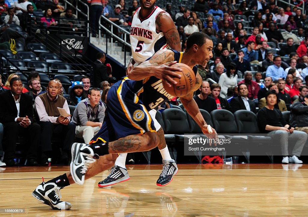 George Hill #3 of the Indiana Pacers handles the ball against the Atlanta Hawks at Philips Arena on November 7, 2012 in Atlanta, Georgia.