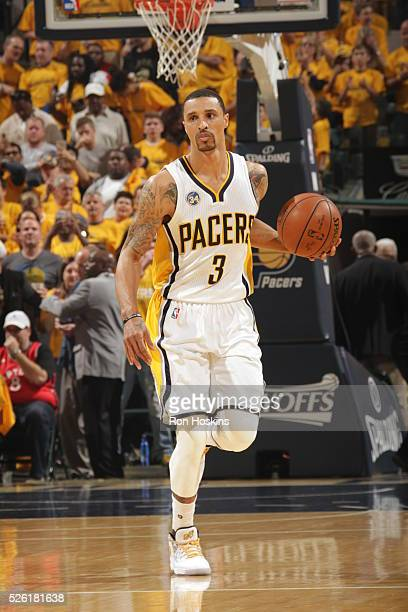 George Hill of the Indiana Pacers handles the ball against the Toronto Raptors in Game Six of the Eastern Conference Quarterfinals during the 2016...
