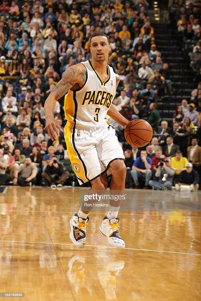 George Hill #3 of the Indiana Pacers handles the ball against the Los Angeles Lakers on March 15, 2013 at Bankers Life Fieldhouse in Indianapolis, Indiana.