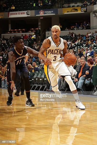 George Hill of the Indiana Pacers handles the ball against the New Orleans Pelicans during a preseason game on October 3 2015 at Bankers Life...
