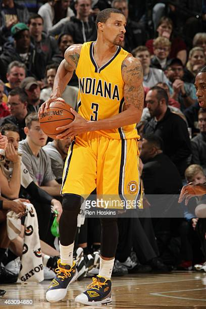 George Hill of the Indiana Pacers handles the ball against the San Antonio Spurs on February 9 2015 at Bankers Life Fieldhouse in Indianapolis...