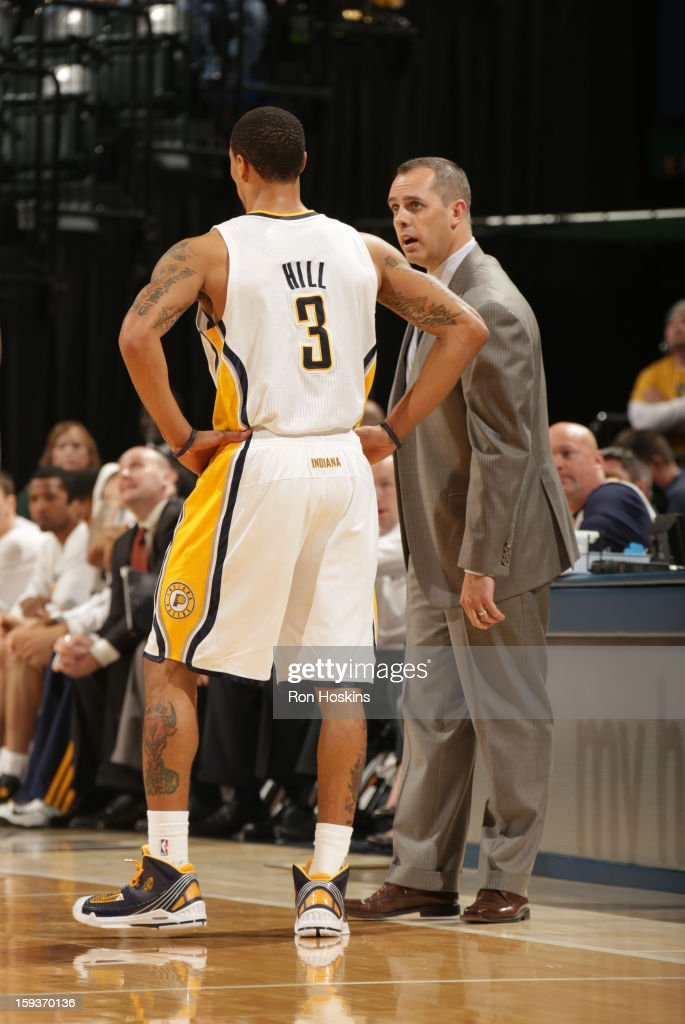 George Hill #3 of the Indiana Pacers listens to Head Coach Frank Vogel of the Indiana Pacers during the game between the Indiana Pacers and the Charlotte Bobcats on January 12, 2013 at Bankers Life Fieldhouse in Indianapolis, Indiana.