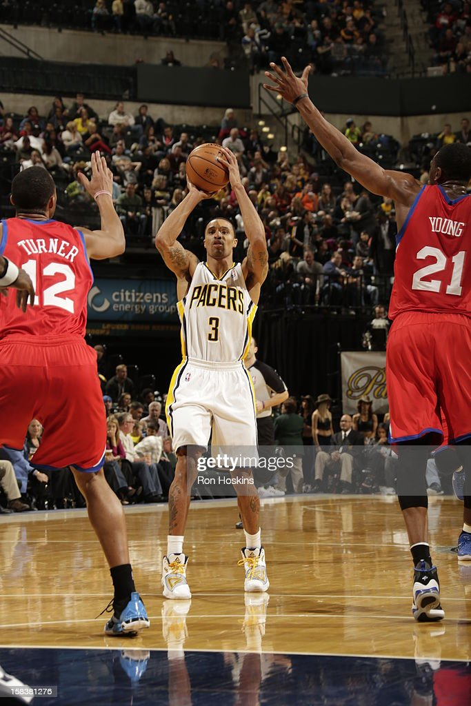 George Hill #3 of the Indiana Pacers looks to pass the ball against <a gi-track='captionPersonalityLinkClicked' href=/galleries/search?phrase=Evan+Turner&family=editorial&specificpeople=4665764 ng-click='$event.stopPropagation()'>Evan Turner</a> #12 and <a gi-track='captionPersonalityLinkClicked' href=/galleries/search?phrase=Thaddeus+Young&family=editorial&specificpeople=3847270 ng-click='$event.stopPropagation()'>Thaddeus Young</a> #21 of the Philadelphia 76ers on December 14, 2012 at Bankers Life Fieldhouse in Indianapolis, Indiana.