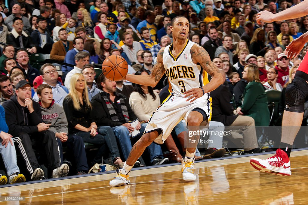 George Hill #3 of the Indiana Pacers looks to pass the ball against the Houston Rockets on January 18, 2013 at Bankers Life Fieldhouse in Indianapolis, Indiana.