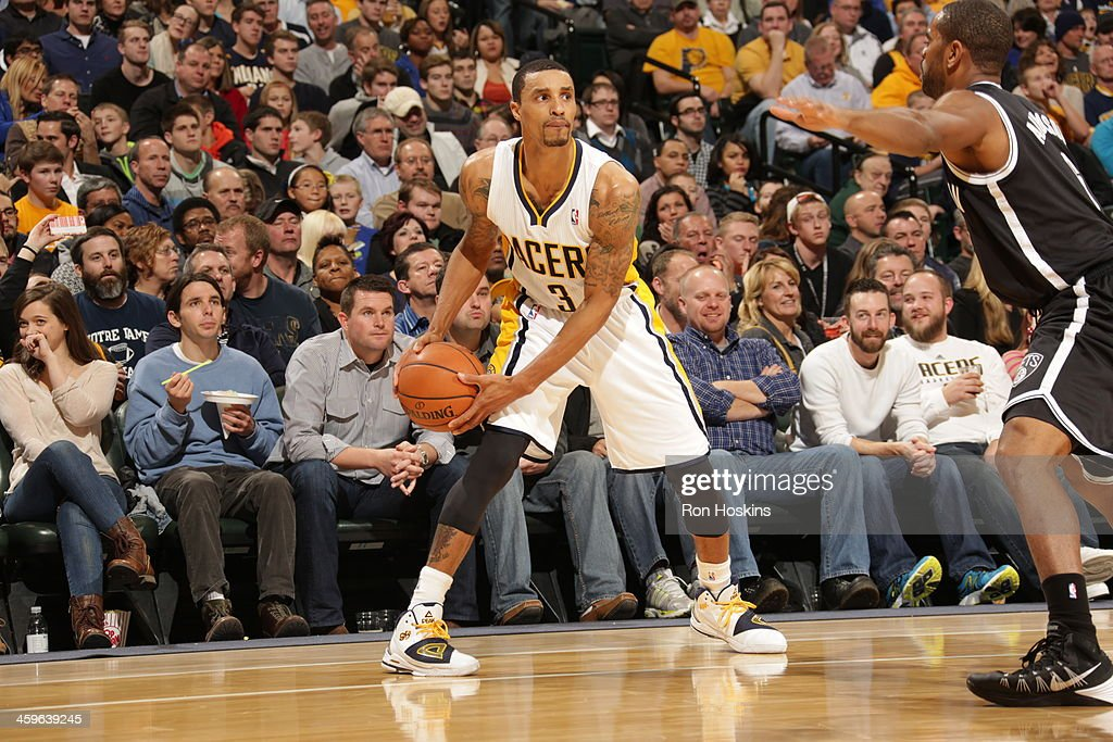 George Hill #3 of the Indiana Pacers looks to pass the ball against the Brooklyn Nets at Bankers Life Fieldhouse on December 28, 2013 in Indianapolis, Indiana.