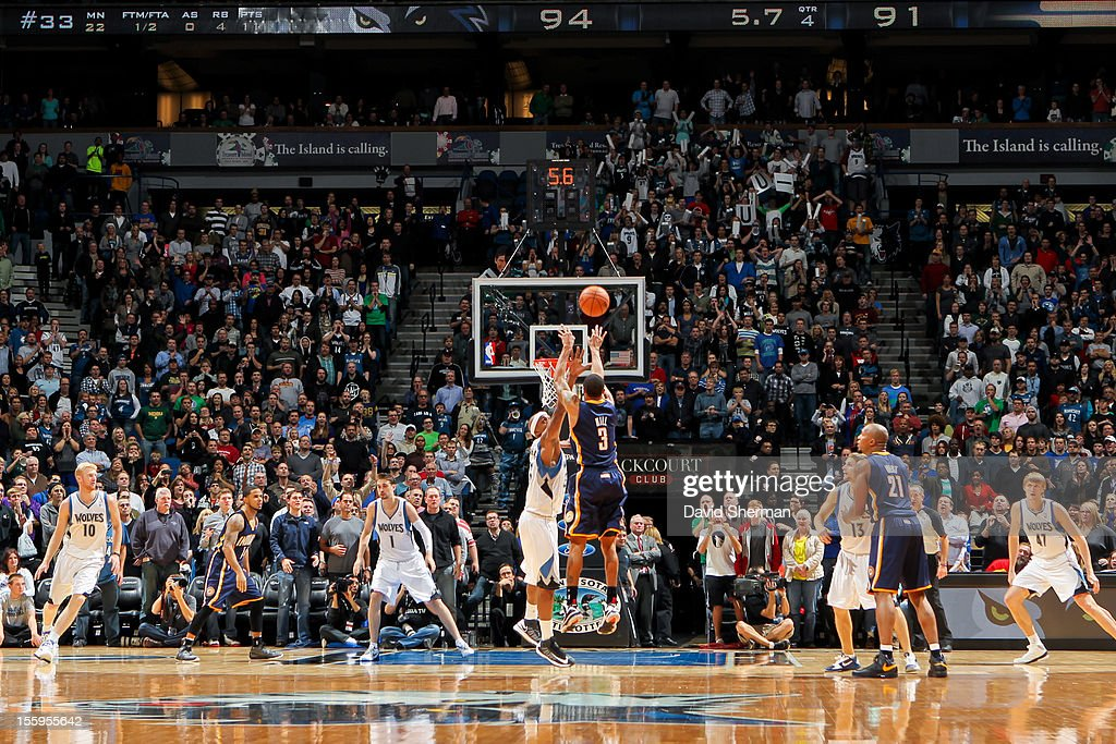 George Hill #3 of the Indiana Pacers makes a game-tying three-pointer with seconds left in the fourth quarter against the Minnesota Timberwolves on November 9, 2012 at Target Center in Minneapolis, Minnesota.