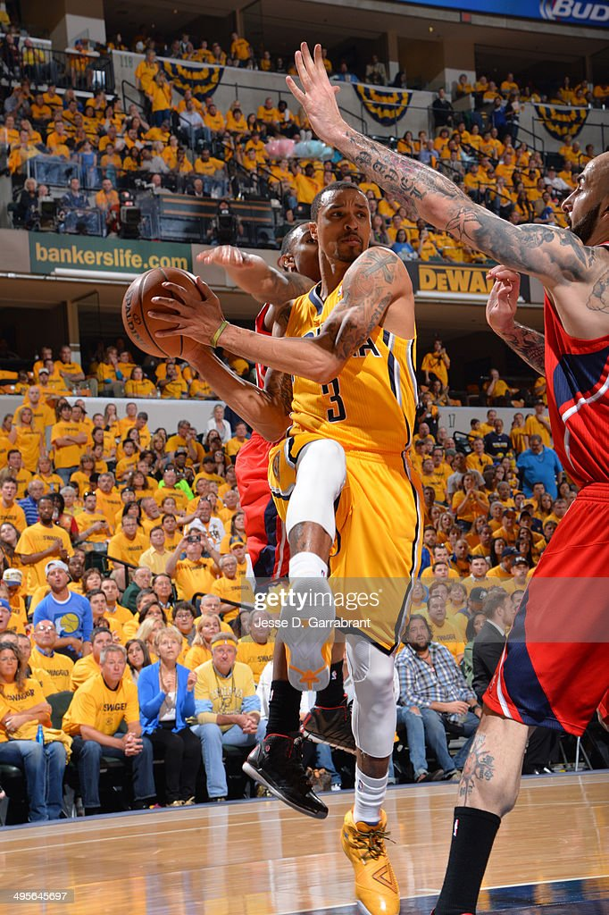 George Hill #3 of the Indiana Pacers passes the ball against the Atlanta Hawks in Game Seven of the Eastern Conference Quarterfinals during the 2014 NBA Playoffs on May 3, 2014 at Bankers Life Fieldhouse in Indianapolis, Indiana.