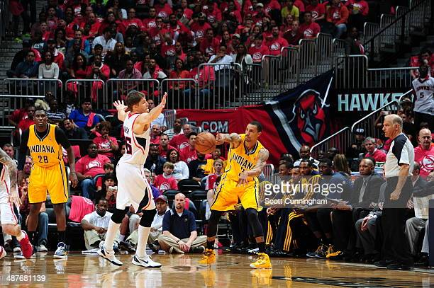 George Hill of the Indiana Pacers passes the ball during Game Six of the Eastern Conference Quarterfinals against the Atlanta Hawks on May 1 2014 at...