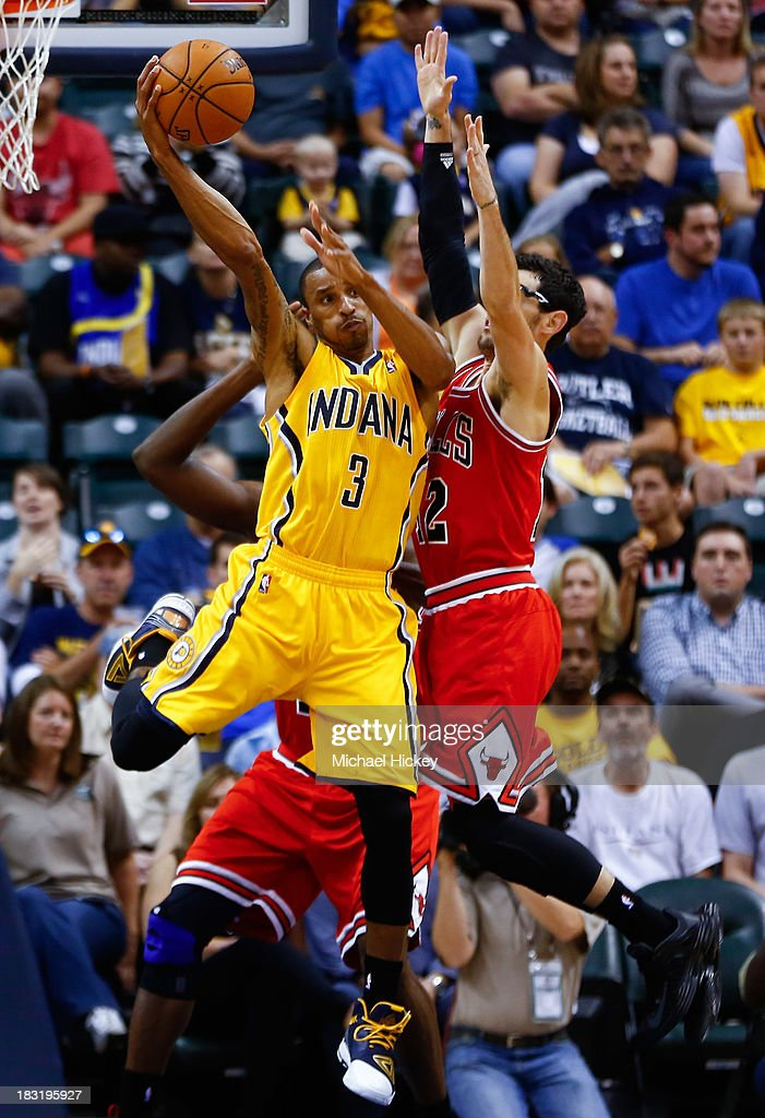 George Hill #3 of the Indiana Pacers passes the ball off as <a gi-track='captionPersonalityLinkClicked' href=/galleries/search?phrase=Kirk+Hinrich&family=editorial&specificpeople=201629 ng-click='$event.stopPropagation()'>Kirk Hinrich</a> #12 of the Chicago Bulls defends on October 5, 2013 at Bankers Life Fieldhouse in Indianapolis, Indiana. Chicago defeated Indiana 82-76.