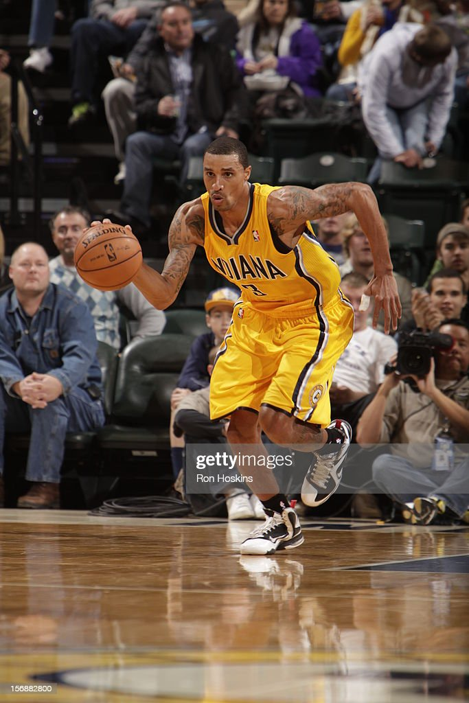 George Hill #3 of the Indiana Pacers pushes the ball up the court vs the San Antonio Spurs on November 23, 2012 at Bankers Life Fieldhouse in Indianapolis, Indiana.