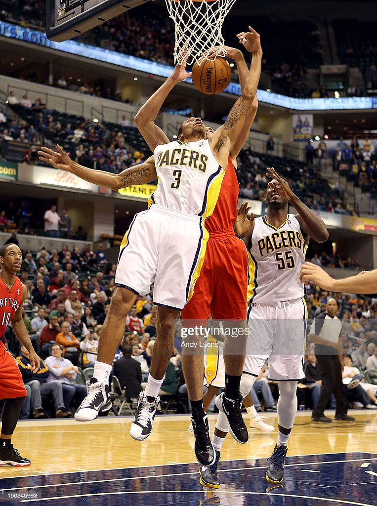George Hill #3 of the Indiana Pacers reaches for a rebound during the NBA game against the Toronto Raptors at Bankers Life Fieldhouse on November 13, 2012 in Indianapolis, Indiana.