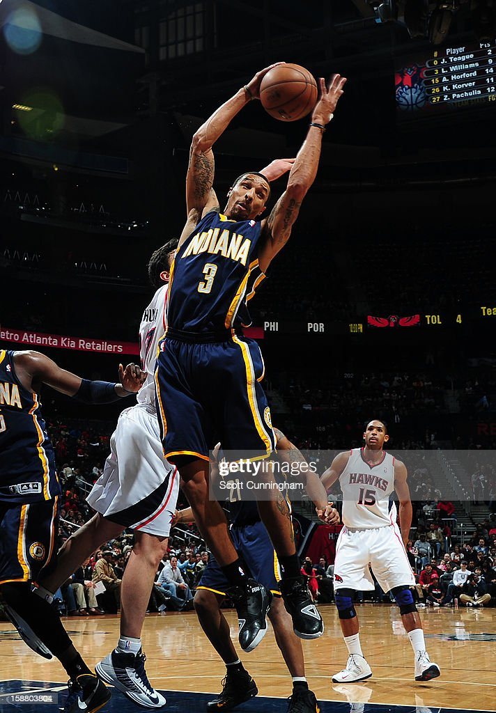 George Hill #3 of the Indiana Pacers rebounds against the Atlanta Hawks on December 29, 2012 at Philips Arena in Atlanta, Georgia.