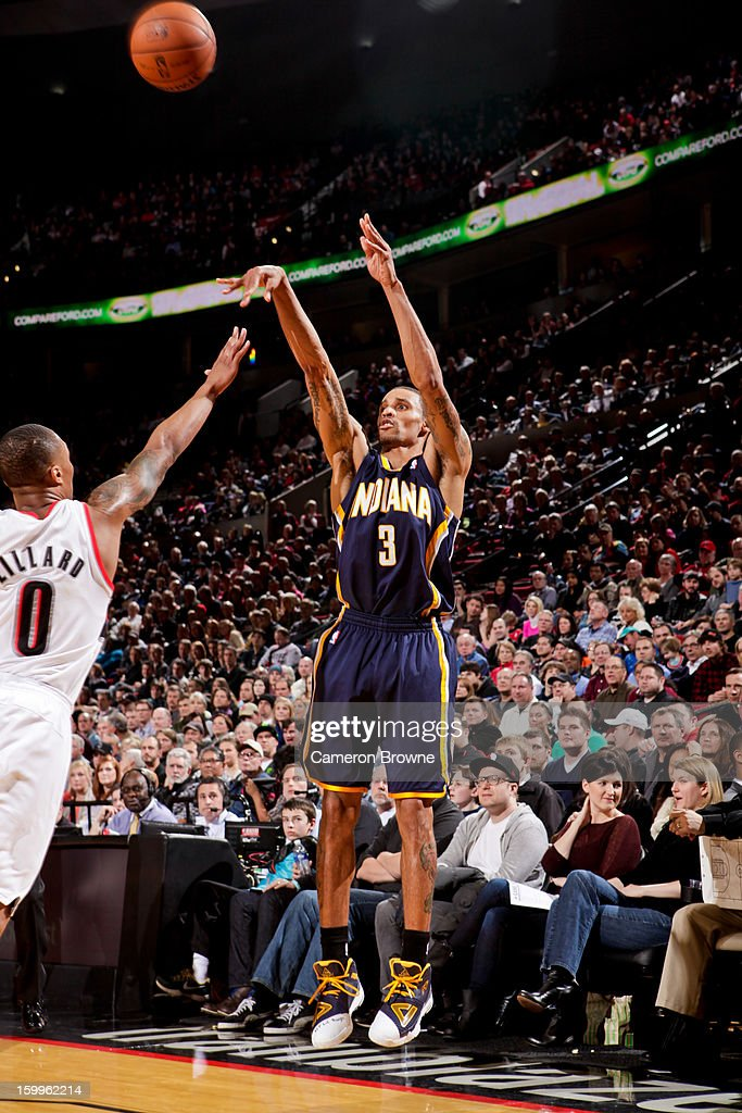 George Hill #3 of the Indiana Pacers shoots a three-pointer against <a gi-track='captionPersonalityLinkClicked' href=/galleries/search?phrase=Damian+Lillard&family=editorial&specificpeople=6598327 ng-click='$event.stopPropagation()'>Damian Lillard</a> #0 of the Portland Trail Blazers on January 23, 2013 at the Rose Garden Arena in Portland, Oregon.