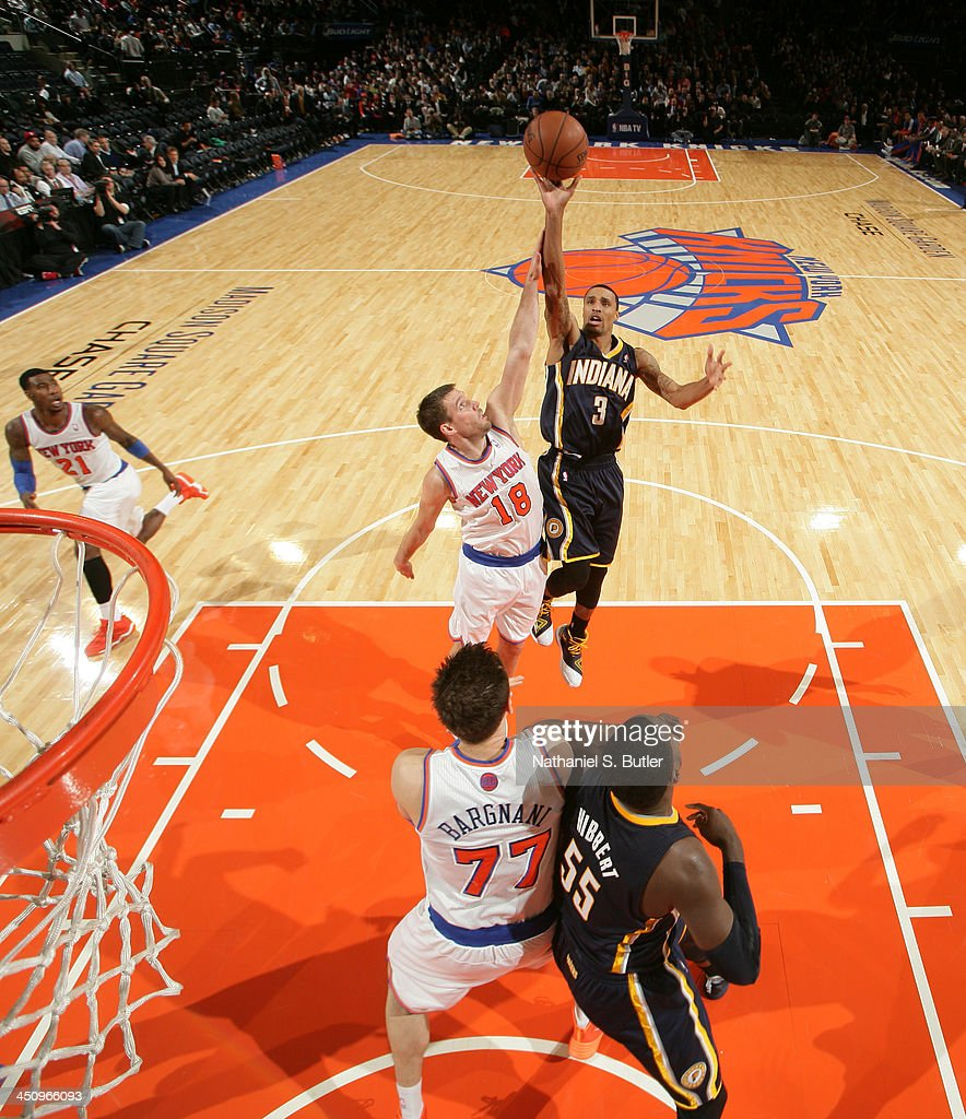 George Hill #3 of the Indiana Pacers shoots against <a gi-track='captionPersonalityLinkClicked' href=/galleries/search?phrase=Beno+Udrih&family=editorial&specificpeople=202616 ng-click='$event.stopPropagation()'>Beno Udrih</a> #18 of the New York Knicks during a game at Madison Square Garden in New York City on November 20, 2013.