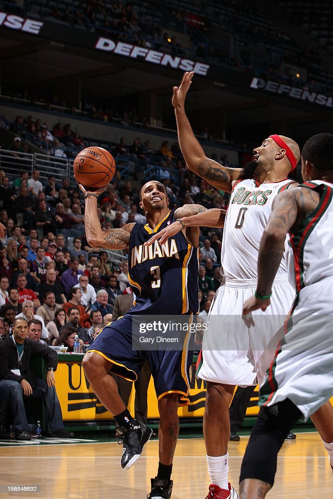 George Hill #3 of the Indiana Pacers shoots against <a gi-track='captionPersonalityLinkClicked' href=/galleries/search?phrase=Drew+Gooden&family=editorial&specificpeople=201750 ng-click='$event.stopPropagation()'>Drew Gooden</a> #0 of the Milwaukee Bucks during the game on December 18, 2012 at the BMO Harris Bradley Center in Milwaukee, Wisconsin.