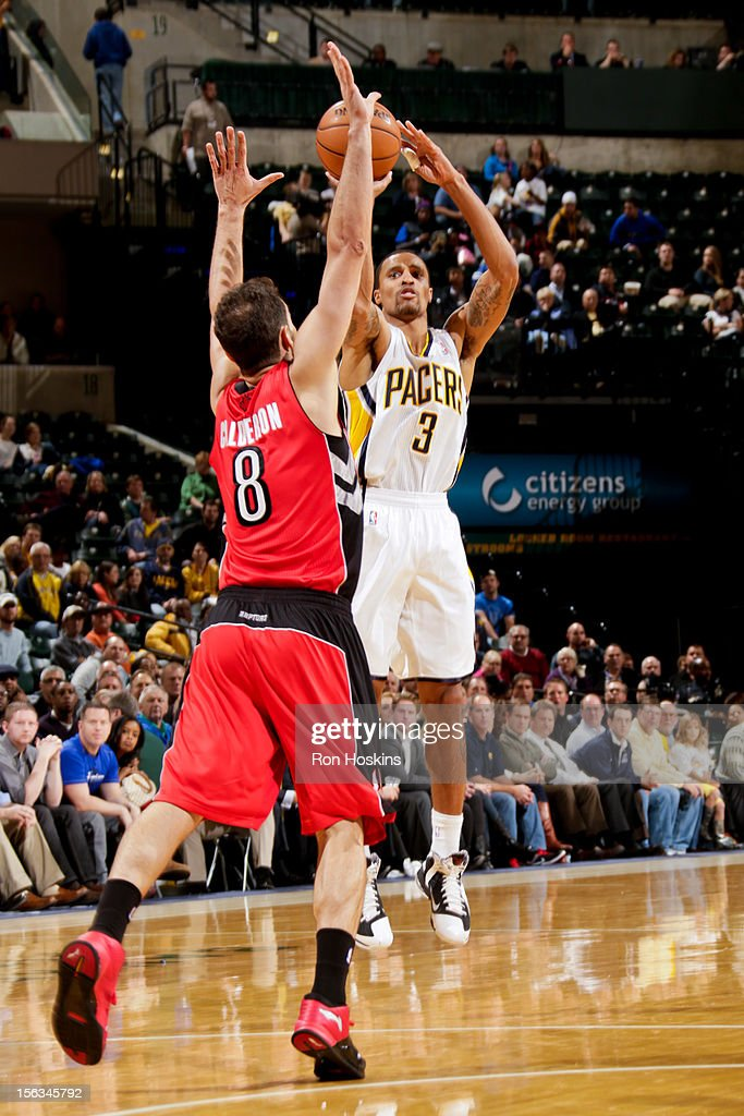 George Hill #3 of the Indiana Pacers shoots against Jose Calderon #8 of the Toronto Raptors on November 13, 2012 at Bankers Life Fieldhouse in Indianapolis, Indiana.