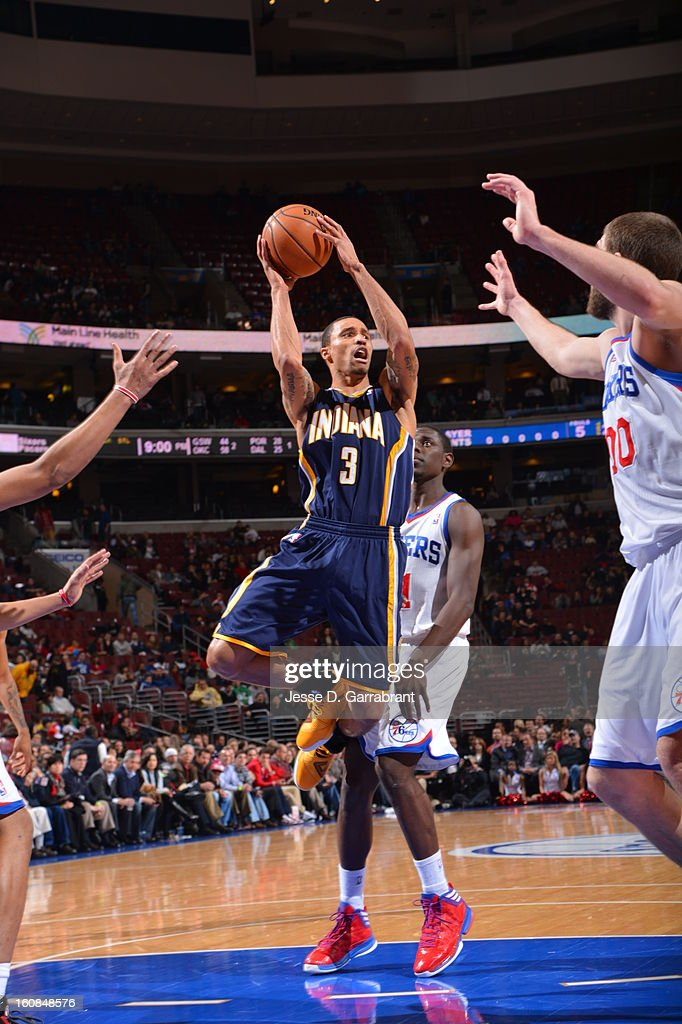 George Hill #3 of the Indiana Pacers shoots against Jrue Holiday #11 and Spencer Hawes #00 of the Philadelphia 76ers during the game at the Wells Fargo Center on February 6, 2013 in Philadelphia, Pennsylvania.