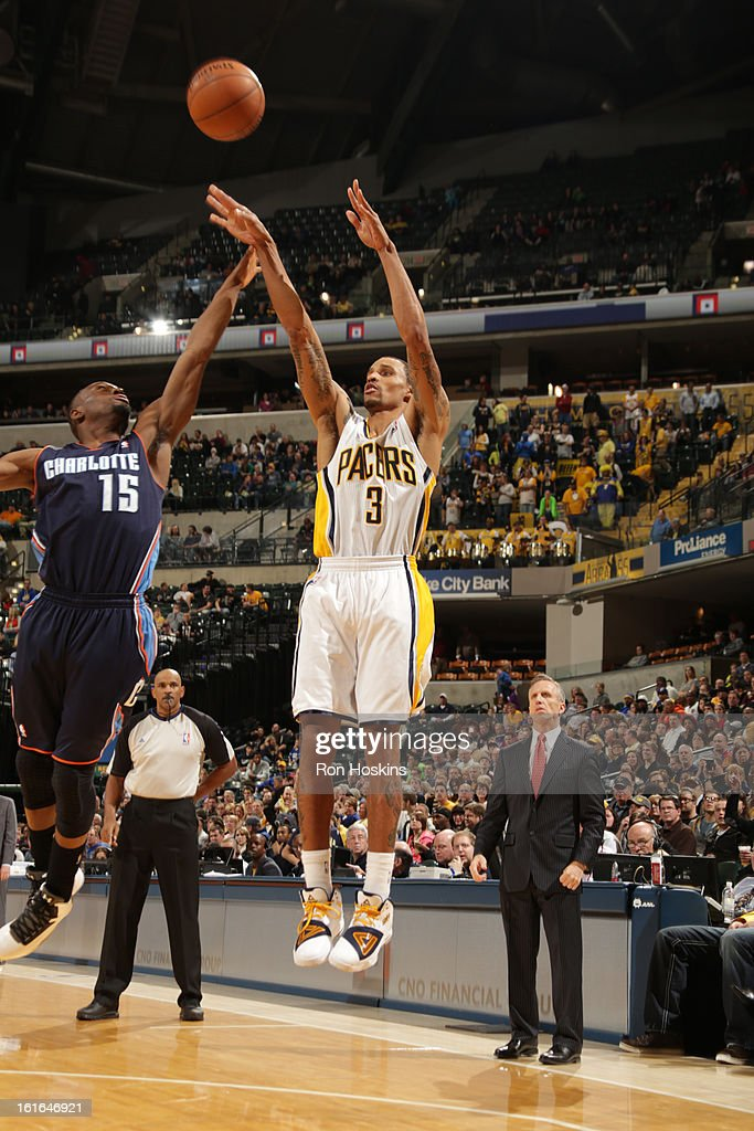 George Hill #3 of the Indiana Pacers shoots against Kemba Walker #15 of the Charlotte Bobcats on February 13, 2013 at Bankers Life Fieldhouse in Indianapolis, Indiana.