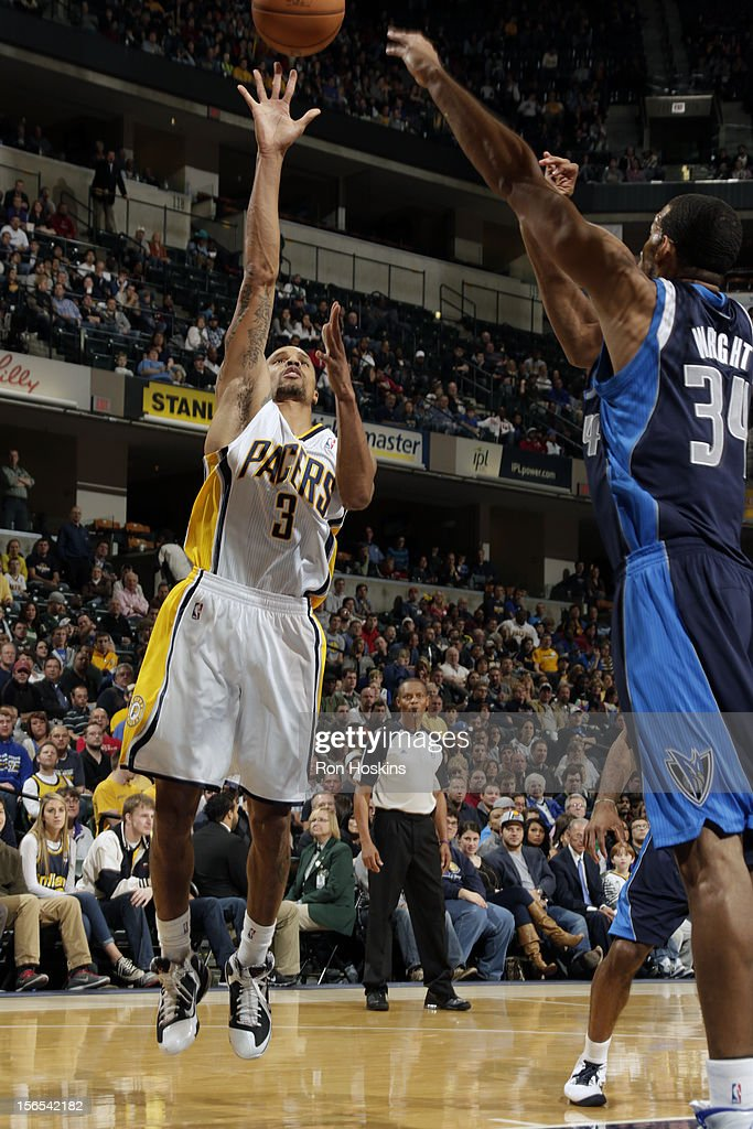 George Hill #3 of the Indiana Pacers shoots against the Dallas Mavericks on November 16, 2012 at Bankers Life Fieldhouse in Indianapolis, Indiana.