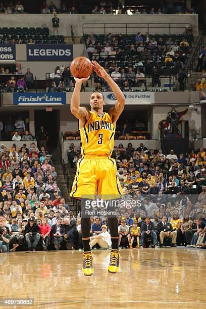George Hill of the Indiana Pacers shoots against the Washington Wizards during the game on April 14 2015 at the Bankers Life Fieldhouse in...