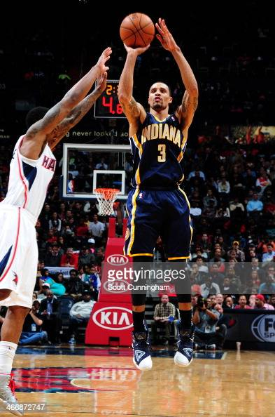 George Hill of the Indiana Pacers shoots the ball against the Atlanta Hawks on February 4 2014 at Philips Arena in Atlanta Georgia NOTE TO USER User...