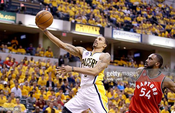 George Hill of the Indiana Pacers shoots the ball against the Toronto Raptors in game six of the 2016 NBA Playoffs Eastern Conference Quarterfinals...