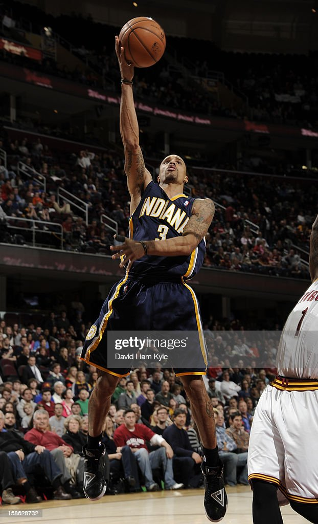 George Hill #3 of the Indiana Pacers tosses up the shot against the Cleveland Cavaliers at The Quicken Loans Arena on December 21, 2012 in Cleveland, Ohio.