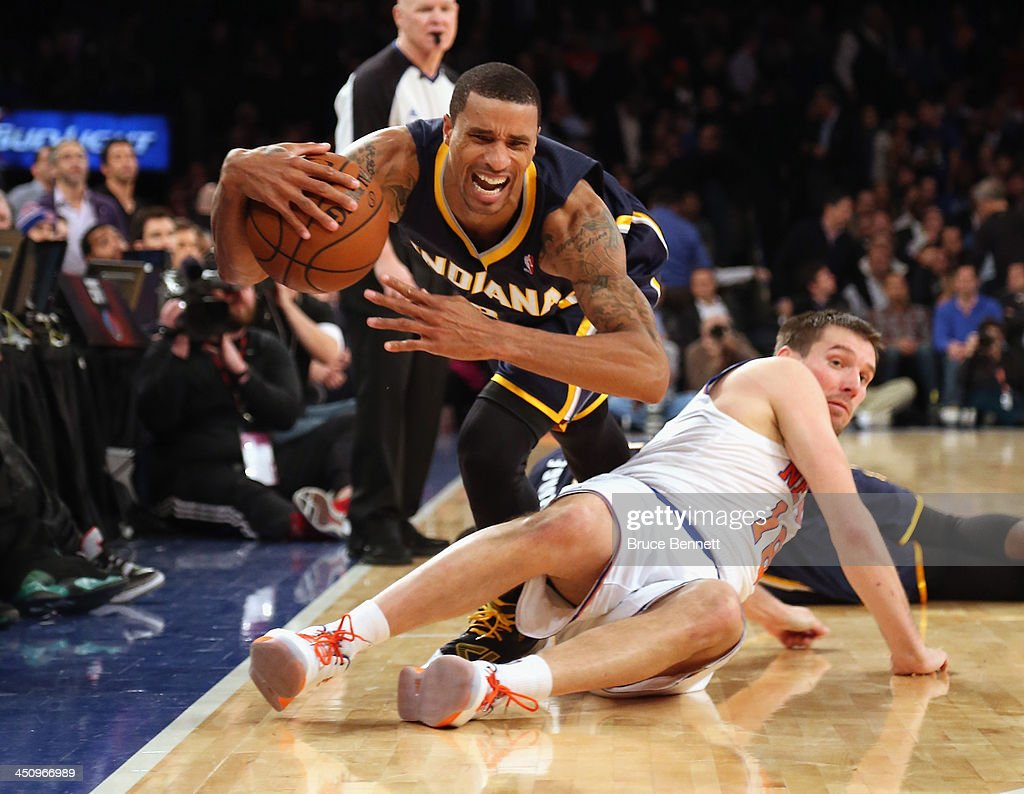 George Hill #3 of the Indiana Pacers trips over <a gi-track='captionPersonalityLinkClicked' href=/galleries/search?phrase=Beno+Udrih&family=editorial&specificpeople=202616 ng-click='$event.stopPropagation()'>Beno Udrih</a> #18 of the New York Knicks at Madison Square Garden on November 20, 2013 in New York City.