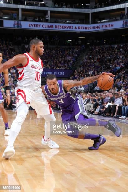George Hill of the Sacramento Kings drives to the basket against Eric Gordon of the Houston Rockets during the game on October 18 2017 at Golden 1...