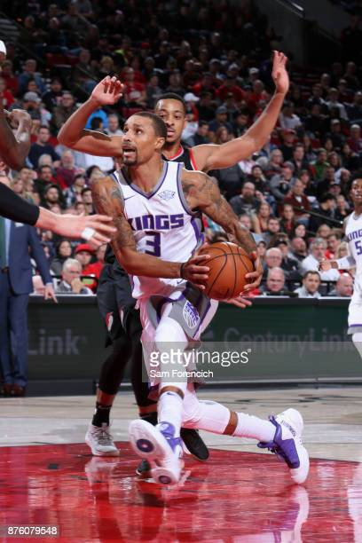 George Hill of the Sacramento Kings goes to the basket against the Portland Trail Blazers on November 18 2017 at the Moda Center in Portland Oregon...