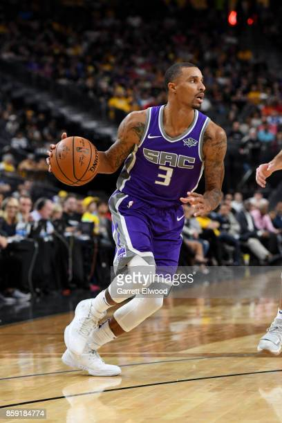 George Hill of the Sacramento Kings handles the ball against the Los Angeles Lakers during a preseason game on October 8 2017 at TMobile Arena in Las...