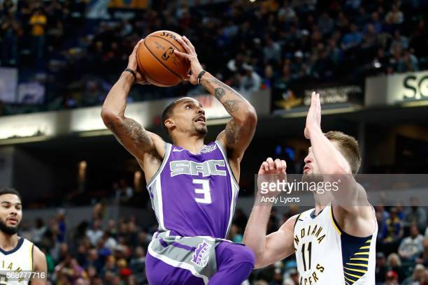 George Hill of the Sacramento Kings shoots the ball against the Indiana Pacers at Bankers Life Fieldhouse on October 31 2017 in Indianapolis Indiana...